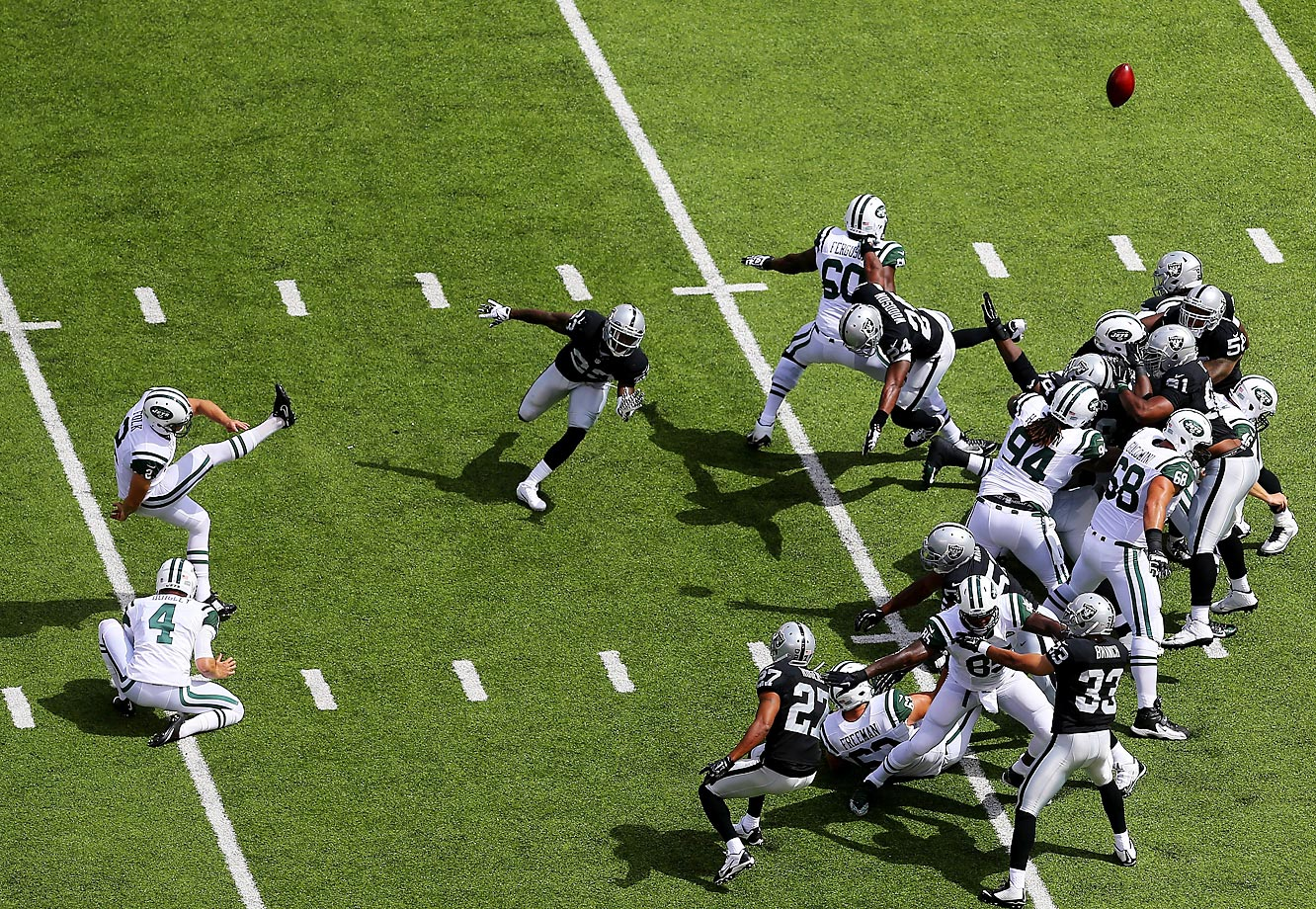 Nick Folk of the New York Jets kicks a field goal against the Oakland Raiders.