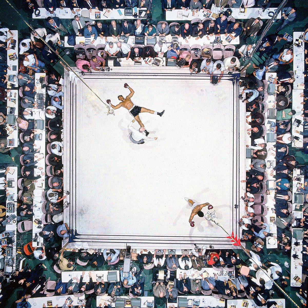 Nov. 14, 1966 | Ali knocks out Cleveland 'Big Cat' Williams in three rounds at the Houston Astrodome to defend his heavyweight title in November 1966. The bout drew a record indoor crowd of 35,460.