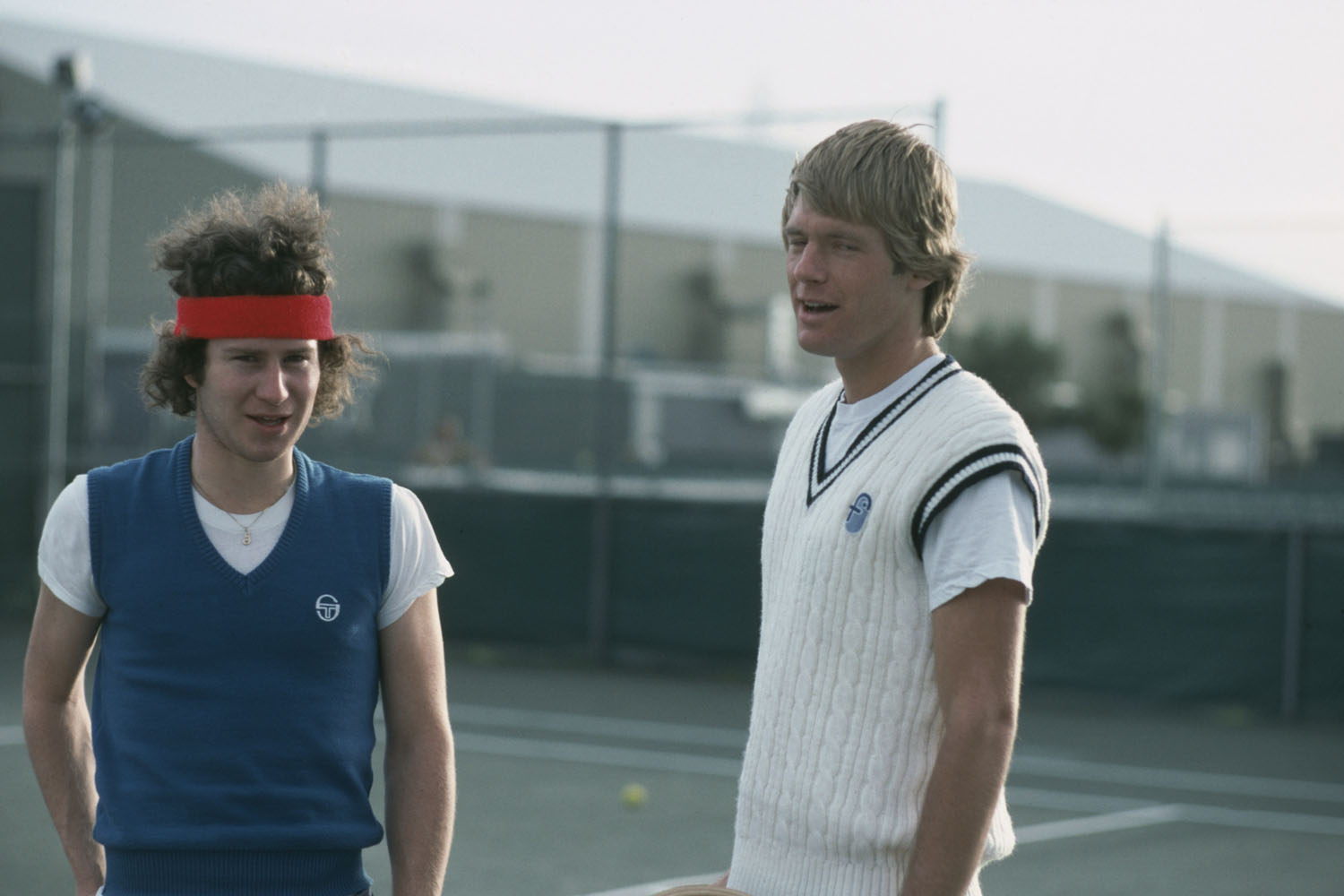 Professional tennis star John McEnroe in training with his personal coach.