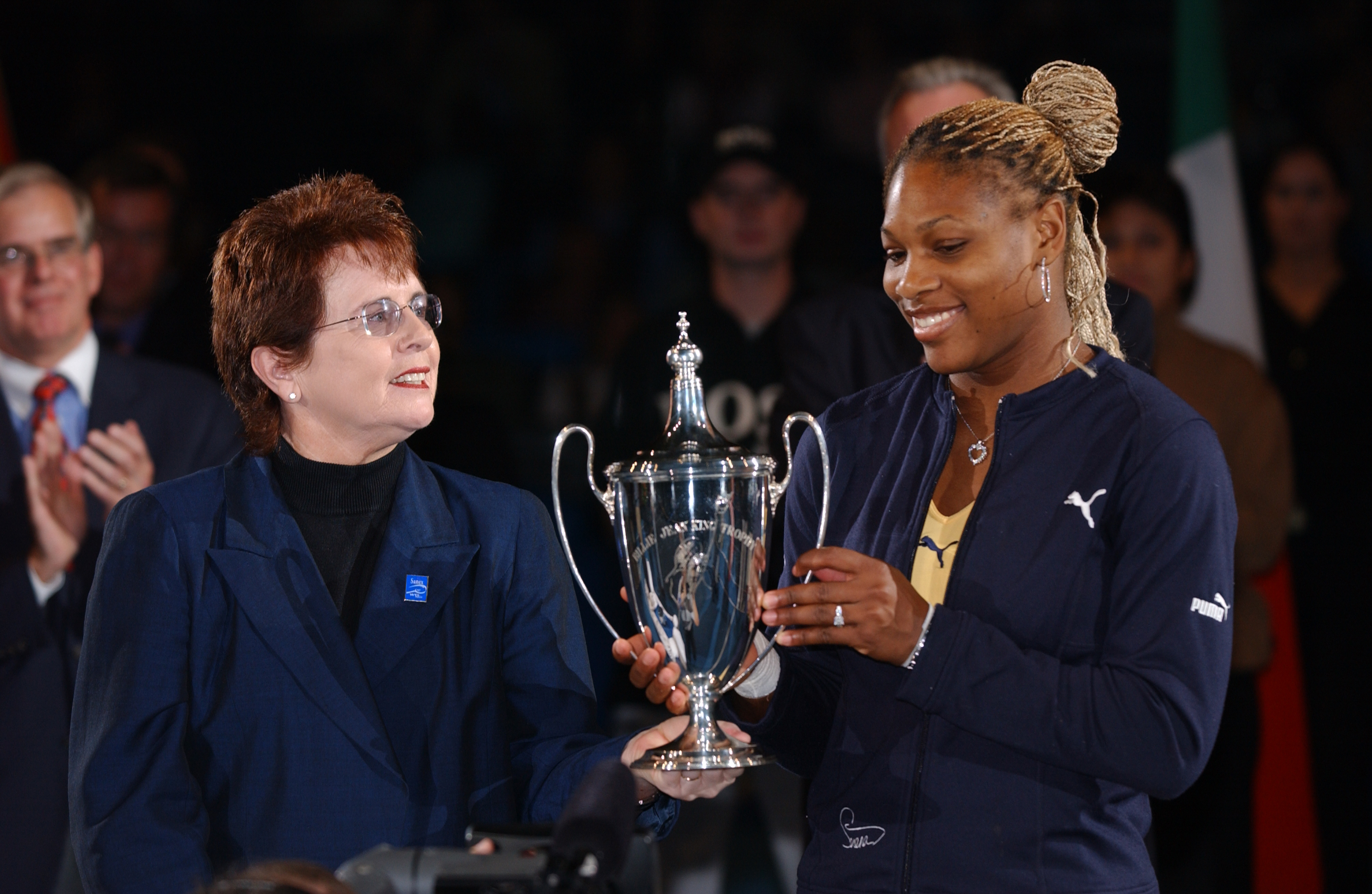 Serena Williams, making her tournament debut, wins the title after Lindsay Davenport withdraws before the final with a knee injury.