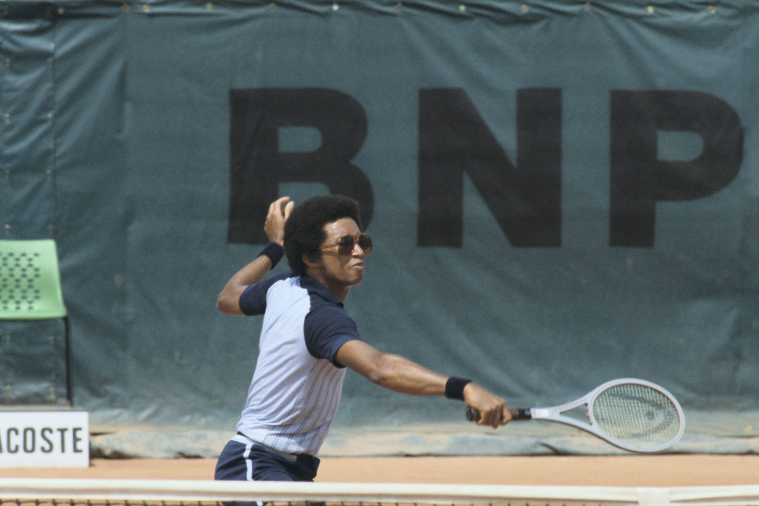 Arthur Ashe, complete with some flashy shades, participates in player training at Roland Garros in 1978.