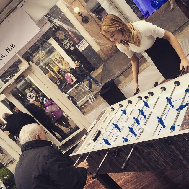 Things we miss about #SISwim today: getting to play foosball with swimsuit models. Sigh. Thanks for the fun, @oldspice.