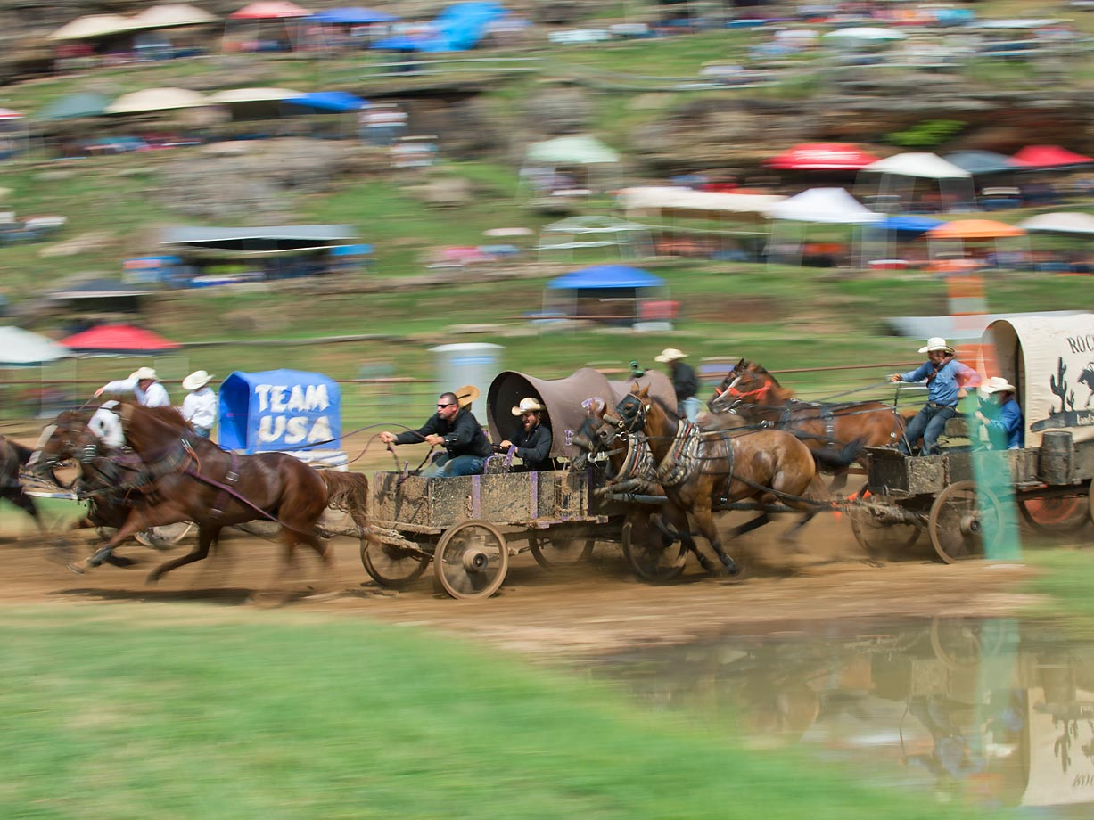 "Team ""B & B Farms"" goes flying through the dip and speeds towards the first turn in the Classic Wagon Division."