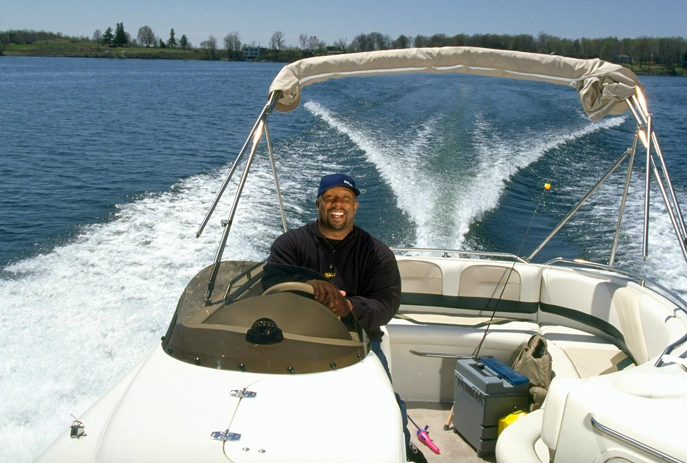 The former Twins star rides in his fishing boat in 1997. The 2001 Hall of Fame inductee hit .316 in his career but was forced to retire before the 1996 season due to loss of vision in his right eye from glaucoma.