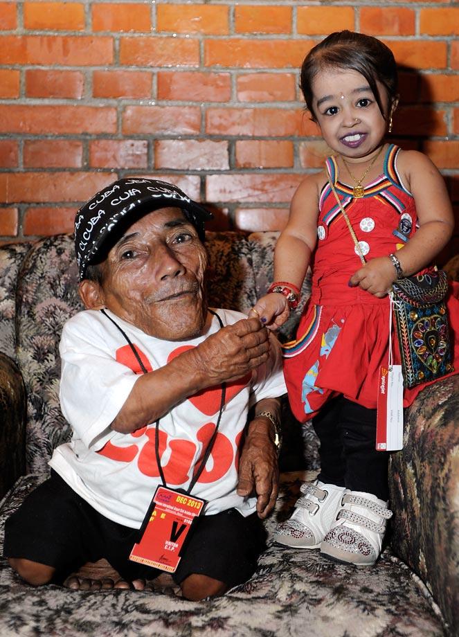 Nepalese Chandra Bahadur Dangi, 72, poses with Indian Jyoti Amge, 19, the world's shortest woman.