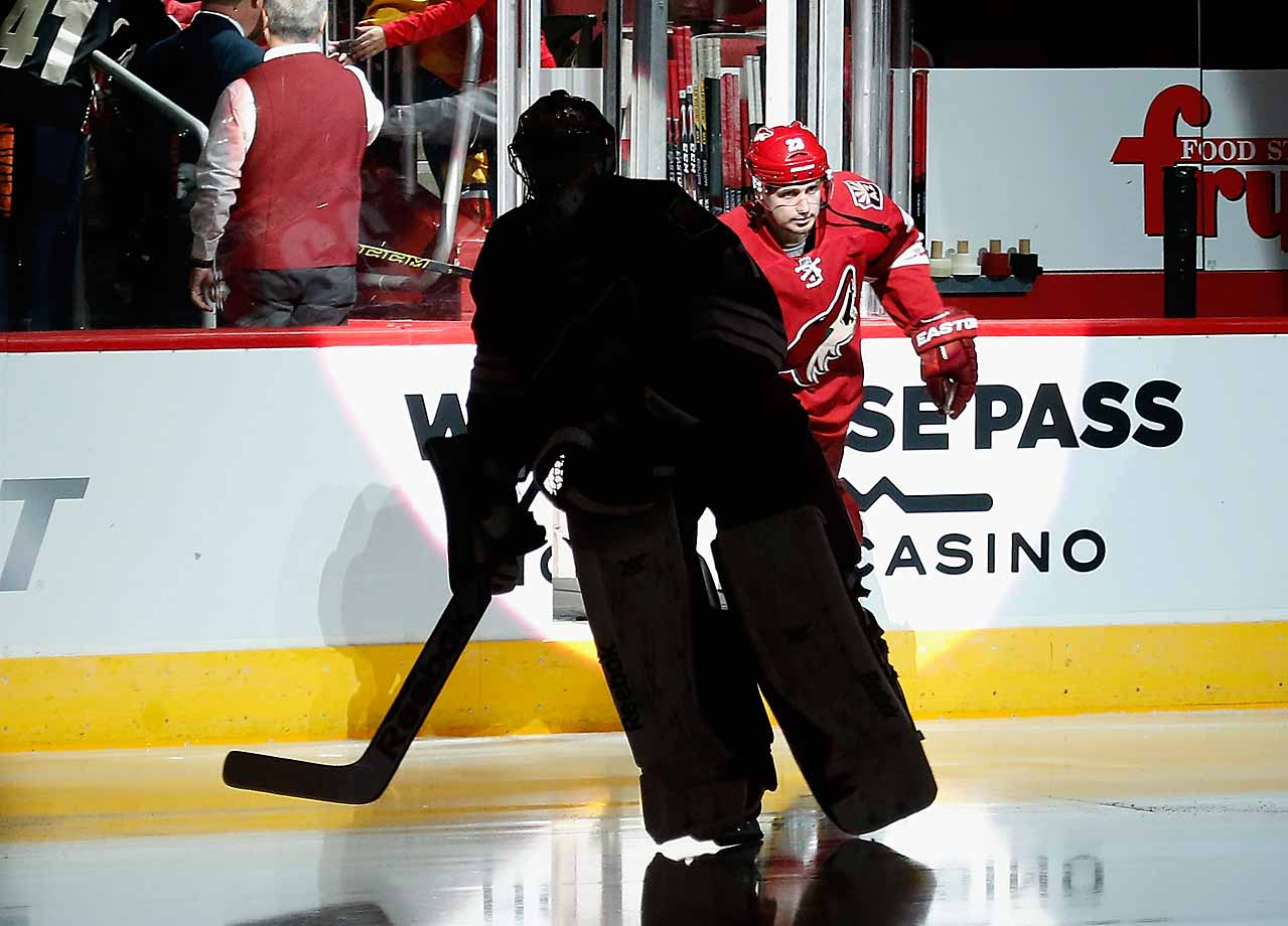 The Coyotes' otherwise reliable goaltender, here taking the ice at Glendale, Arizona's Gila River Arena for a game against Florida, has been a shadow of his old self during the season's first month. On this night (Oct. 25, 2014) he shone, winning 2-1 in OT.