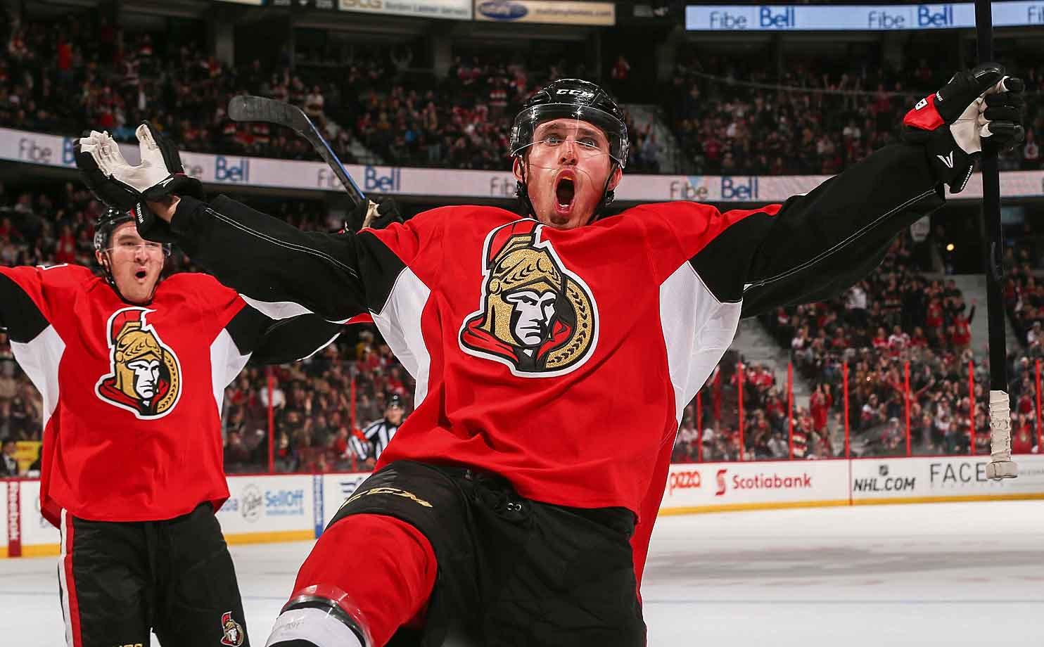 All hail! The Senators defenseman celebrates the game winning goal late in the third period against the Red Wings at Ottawa's Canadian Tire Centre on November 4, 2014.