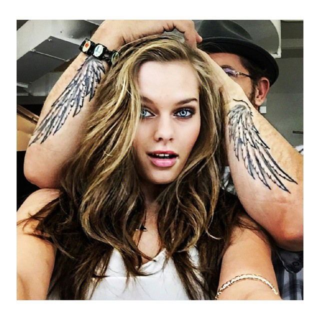 Had a great time shooting @guess for @macys .com the other day with my #wcw (wingcrushwednesday) @joshuabeauty #loveguess #macys #wings #tattoo #hairandmakeup