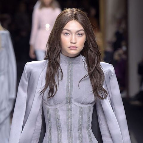 Recognize this gal? It's Gigi Hadid—as a brunette! (Giovanni Giannoni/WWD/REX Shutterstock)