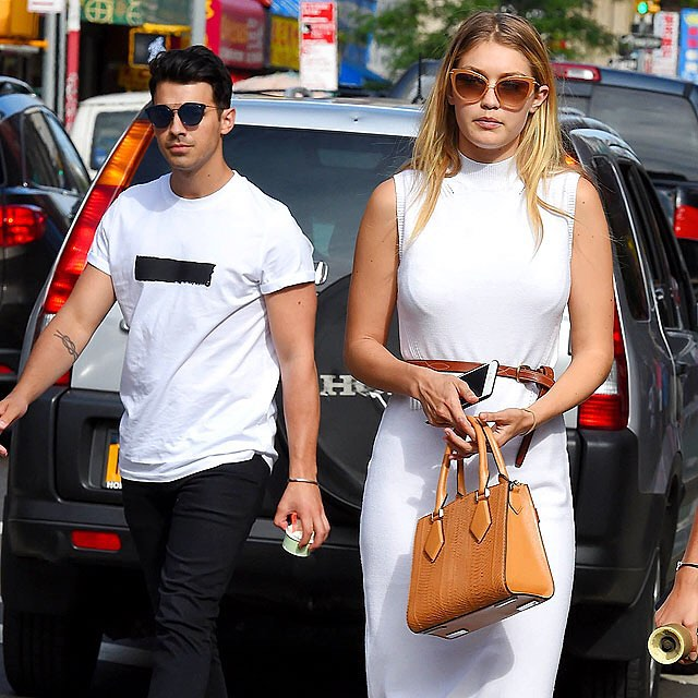 A white hot (maybe) couple? @gigihadid and rumored boyfriend @joejonas hit the streets of NYC on Monday. #startracks | Josiah Kamau/BuzzFoto/Getty
