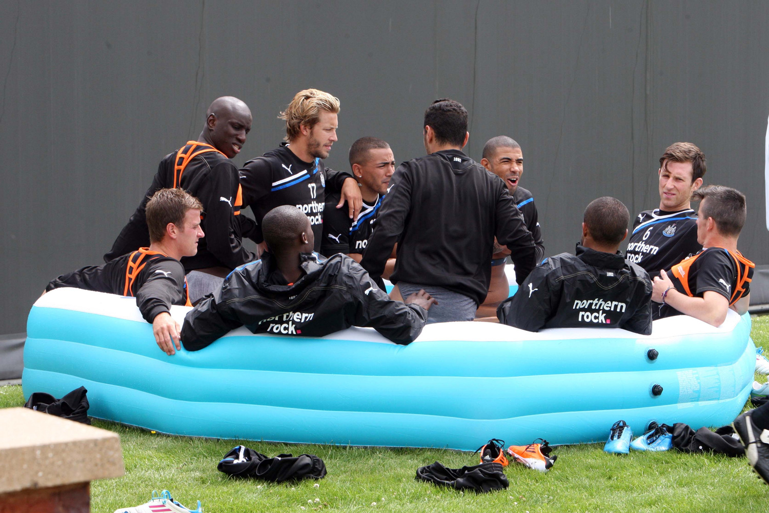 Newcastle United players, who attended a training session at the Little Benton Training Ground in July 2011, enjoy a group recovery session in an inflatable pool filled with ice.