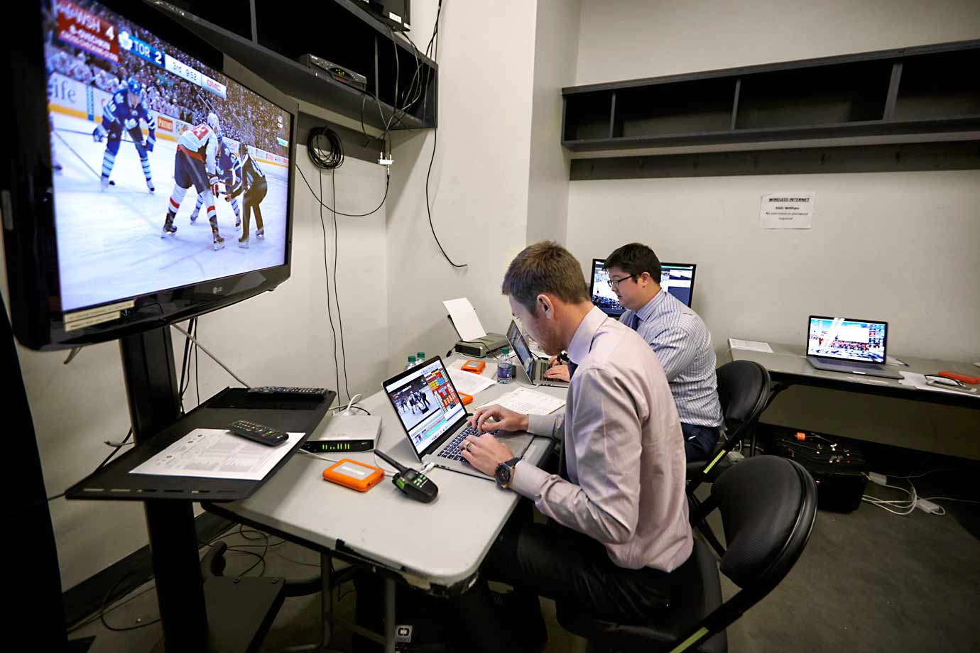 At 9:27 p.m., while the Caps do battle on the ice, members of their coaching staff analyze the action in real time.