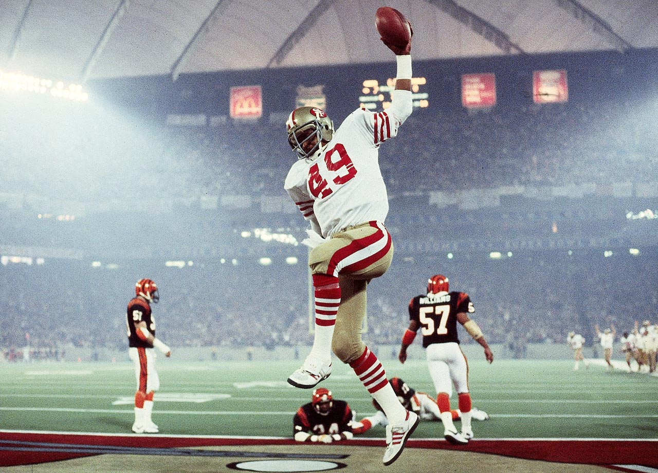 San Francisco 49ers fullback Earl Cooper celebrates after scoring a 10-yard receiving touchdown in the second quarter while Cincinnati Bengals cornerback Lewis Breeden looks on from the ground. Cooper's touchdown gave the Niners a 14-0 lead as they went on to win 26-21.