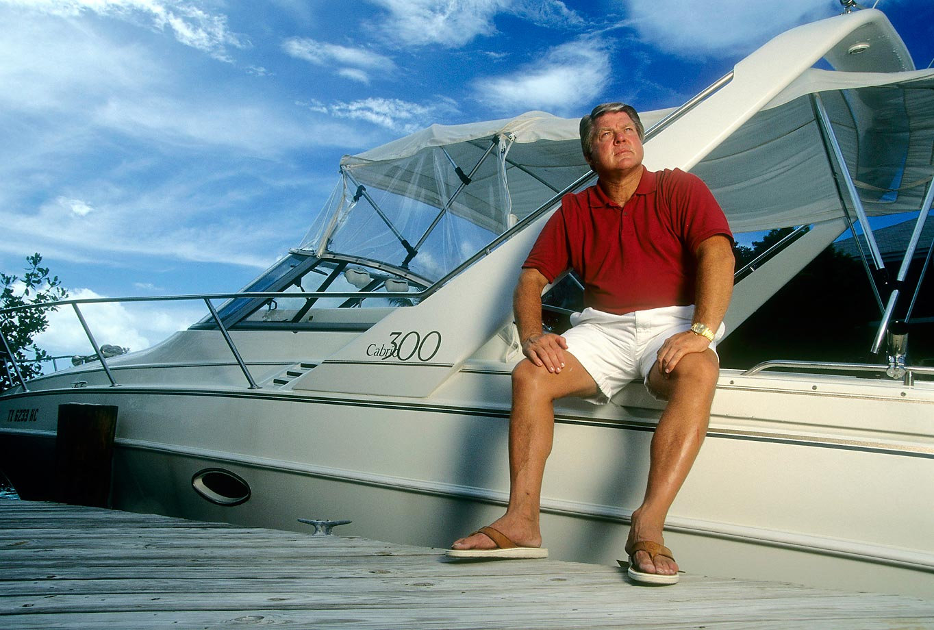 After two years as a TV analyst, Jimmy Johnson returned to coaching with the Miami Dolphins in 1996. In this photo taken that year, Johnson sits on his boat.