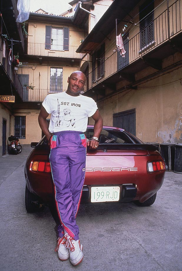 Marvin Hagler leans against his Porsche. Marvelous Marvin had an incredible 62-3-2 record over his career, including 52 knockouts.
