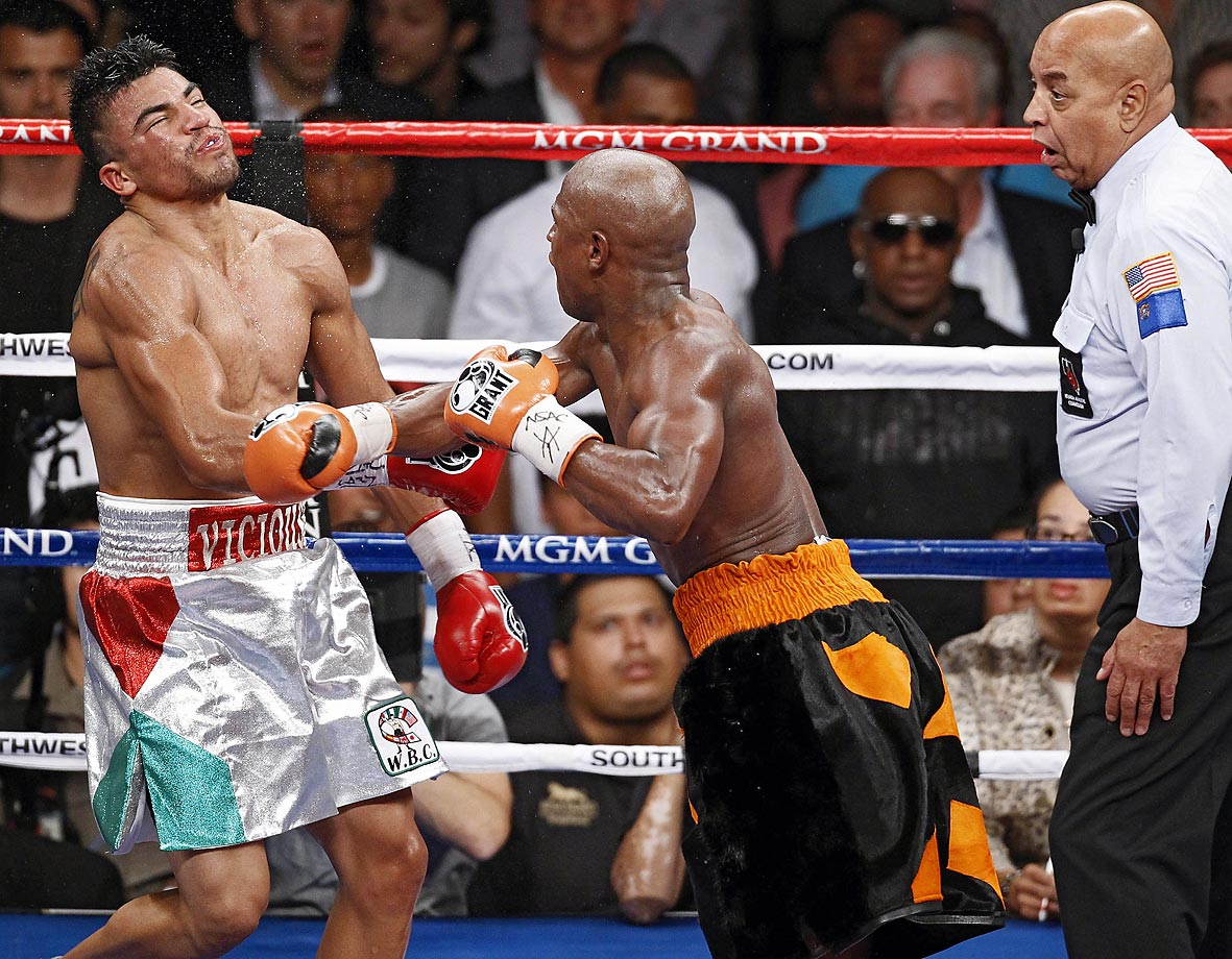 Mayweather drew boos at catcalls with his perhaps unsportsmanlike (but definitely legal) knockout of the 24-year-old Ortiz to win the WBC welterweight title. After Ortiz was warned for head-butting Mayweather, they touched gloves, and Ortiz looked for referee Joe Cortez to signal a restart (Cortez said he did, but Ortiz said he didn't hear it) while Mayweather pounced on his unsuspecting opponent with a left-right combination in the fourth round.