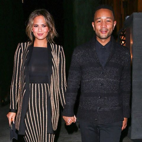 Parents-to-be Chrissy Teigen and John Legend hold hands after a romantic dinner date in L.A.kiss (Maciel/AKM-GSI)
