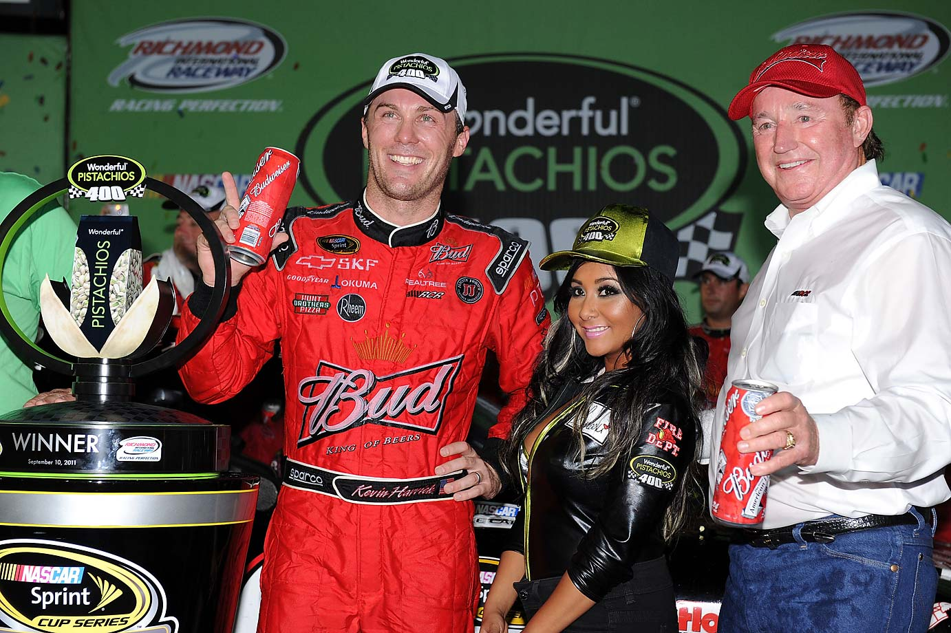 Kevin Harvick celebrates with TV personality Nicole 'Snookie' Polizzi and team owner Richard Childress after winning at Richmond on September 10, 2011.