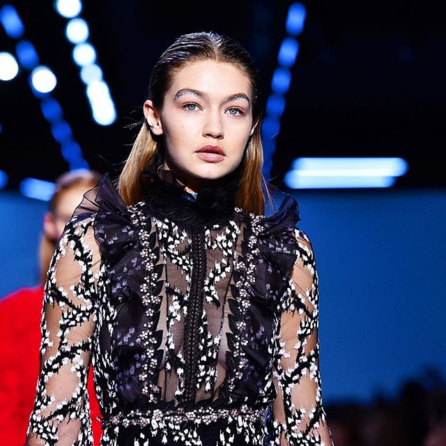 Glitter-lined eyebrows? Sign us up, please. #GigiHadid rocked the subtle-but-standout beauty look on the runway at @giambattistapr and we fell in love. #PFW #FW16 | photo: @gettyimages