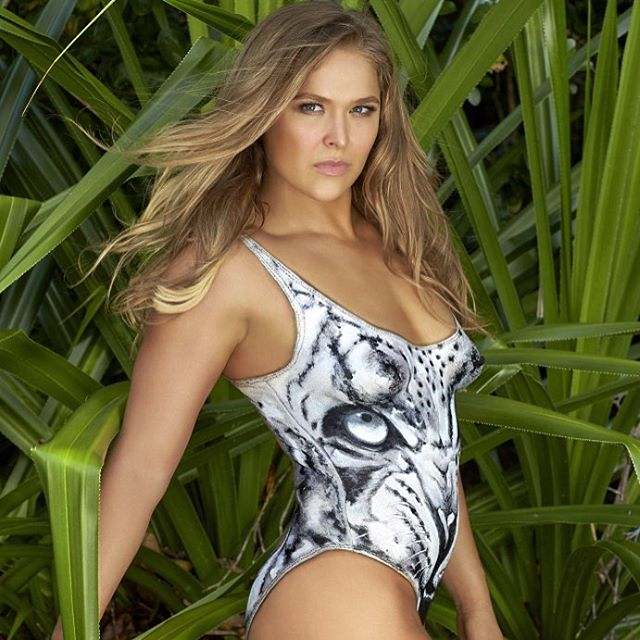 GORGEOUS Covergirl @rondarousey in painted swimsuit inspired by @wearehandsome 'The Fighter' @si_swimsuit 2016 @mj_day @darciebaum photographer @fredericpinet bodypaint & #makebyme #hair @ericgabrielxx #SISWIM #RondaRousey #swimsuit #wearehandsome #PetitStVincent #myteam @smcgathyfay @therealmarissajade #ReelCreations #TrendyTribals #maccosmetics #ajcrimson #makeup #mua #bodypaint #JoanneGair