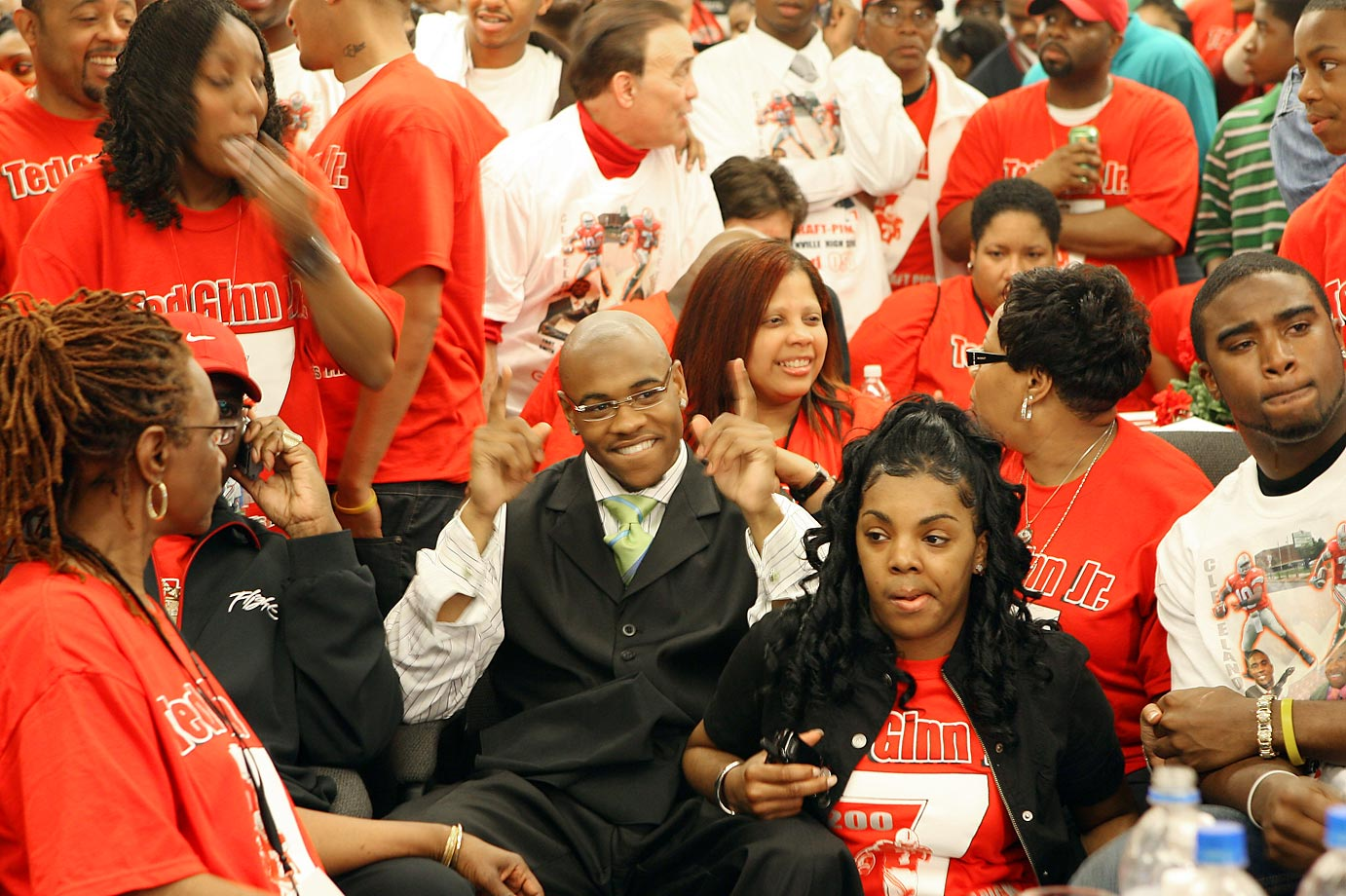 Ohio State wide receiver Ted Ginn Jr. embraces his mother and girlfriend after receiving a phone call from the Miami Dolphins, who chose him with the No. 9 pick in the 2007 draft.