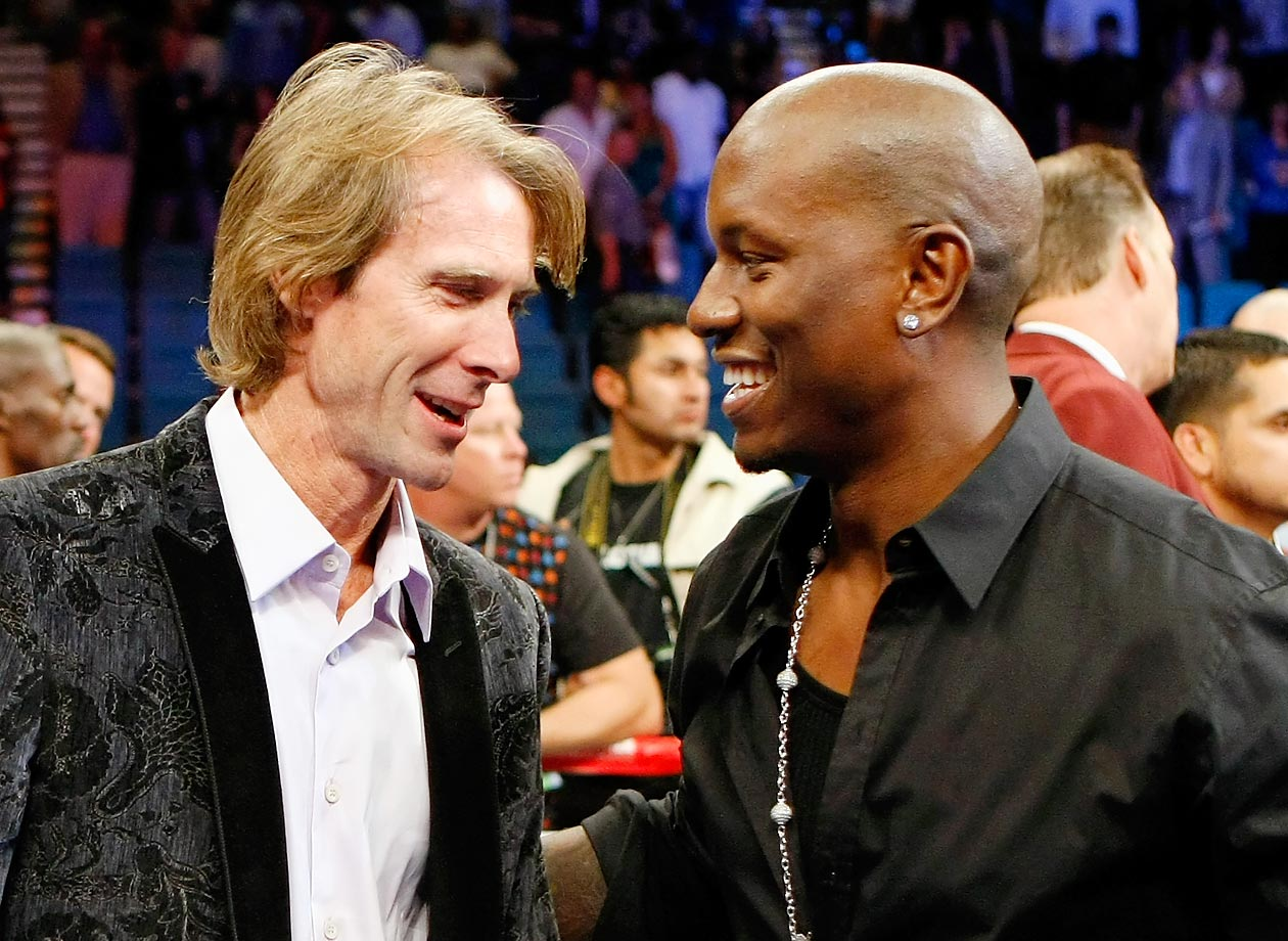 Director Michael Bay and Tyrese Gibson talk after Floyd Mayweather Jr. defeated Juan Manuel Marquez.