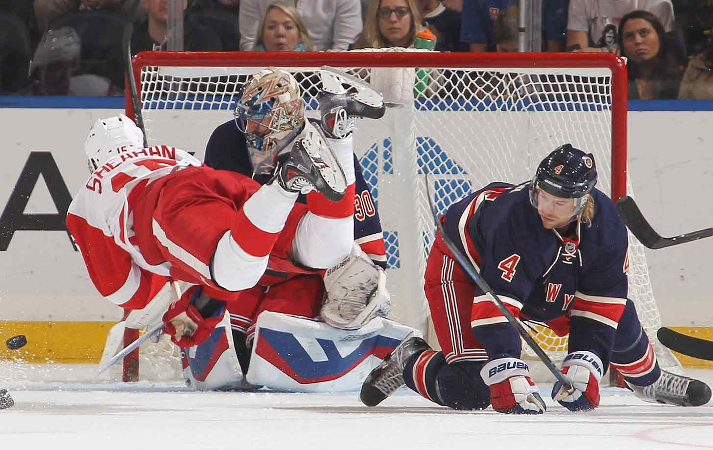 Flying wing: Riley Sheahan of the Red Wings goes airborne like the puck after being tripped by Rangers defenseman Mike Kostka at Madison Square Garden on November 5, 2014.