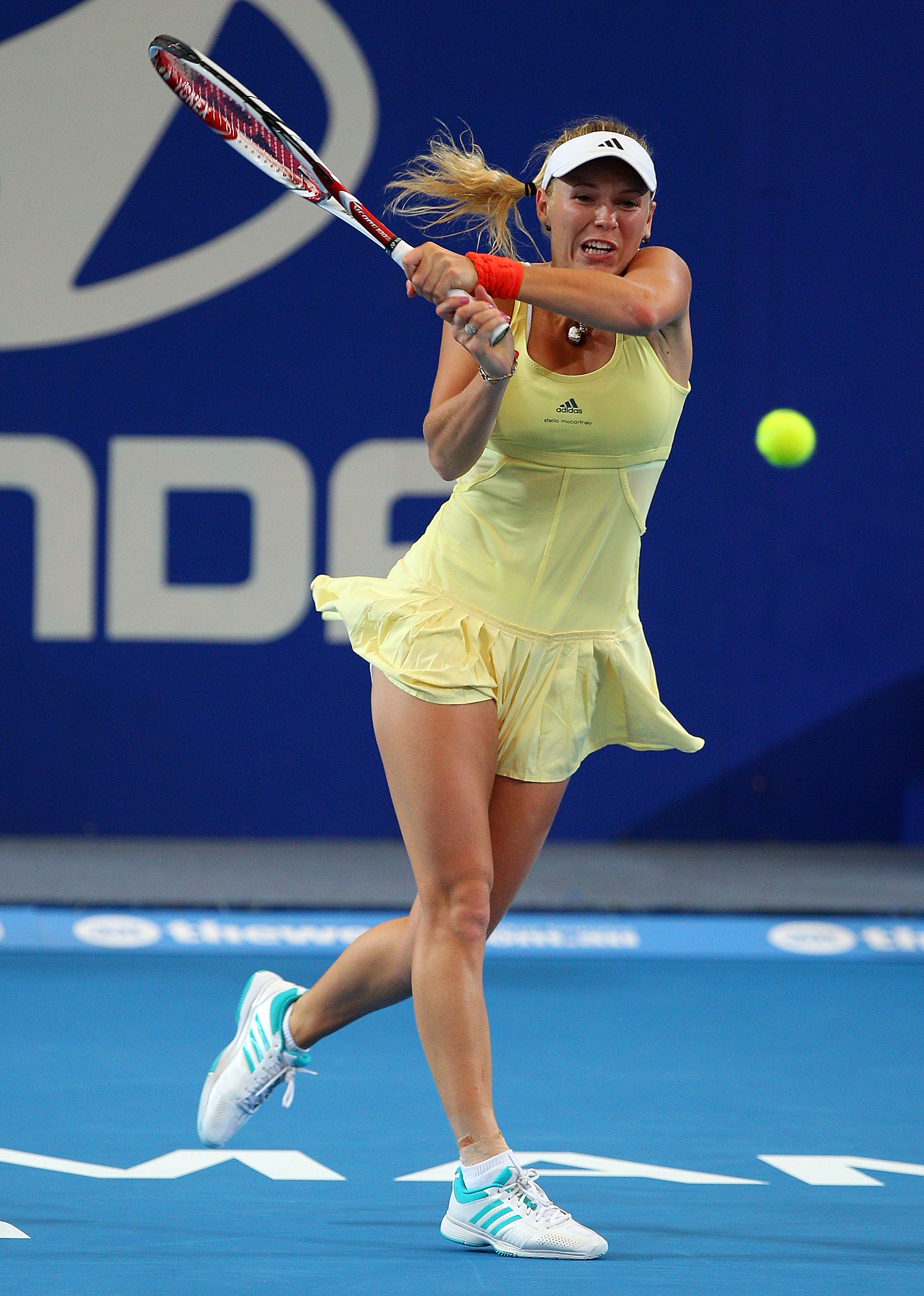 Same dress as the U.S. Open but in a soft yellow. A little sunshine for Sunshine.