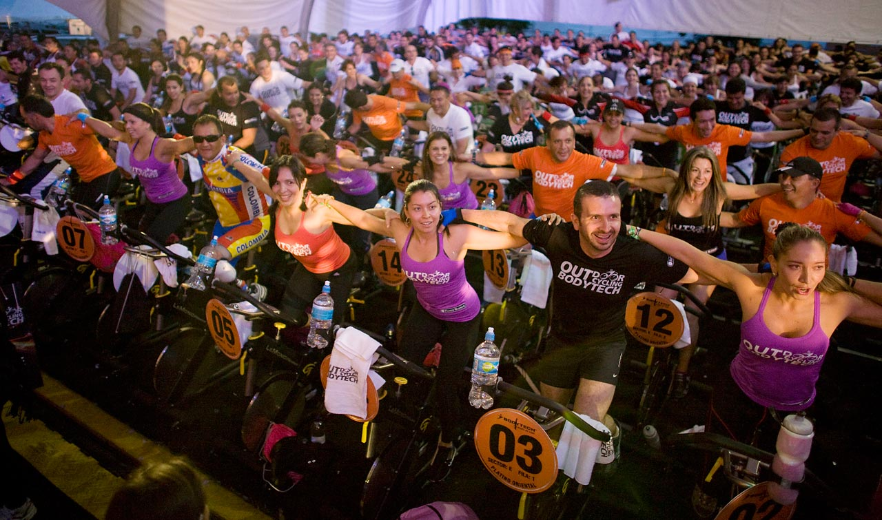 Riders embrace at the start of a spinning marathon in Bogota, Colombia. A record-1,096 people pedaled for three hours to break the Guinness world record for the largest static cycling class.