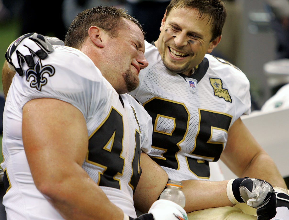 Sept. 25, 2006: Saints fullback Mike Karney is consoled by teammate tight end Ernie Conwell as he weeps at the end of the team's 23-3 win over the Atlanta Falcons.