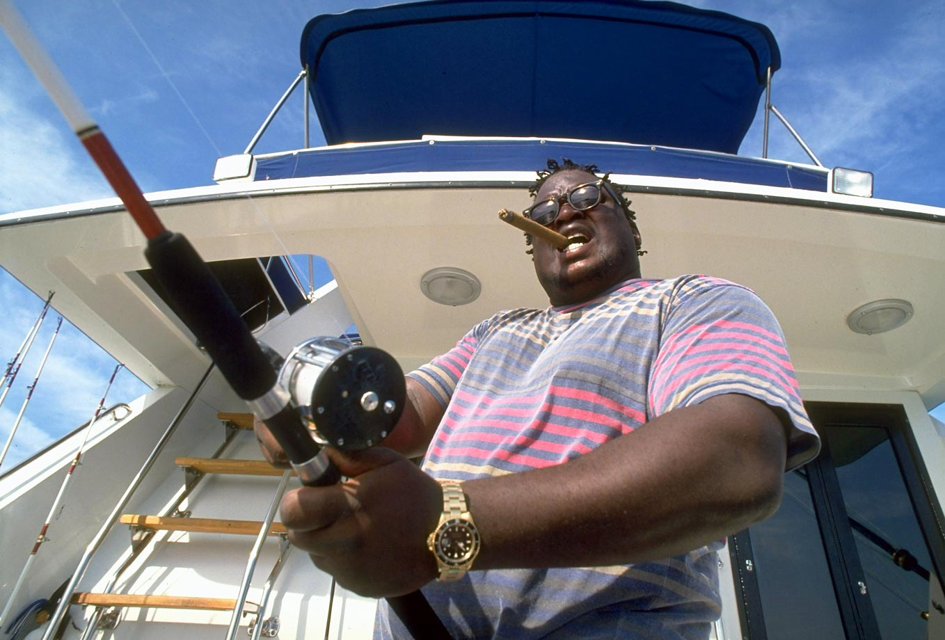 The former heavyweight champion fishes on his boat in Key West in 1993. More than three years earlier, Douglas had knocked out unbeaten champion Mike Tyson to stun the boxing community.