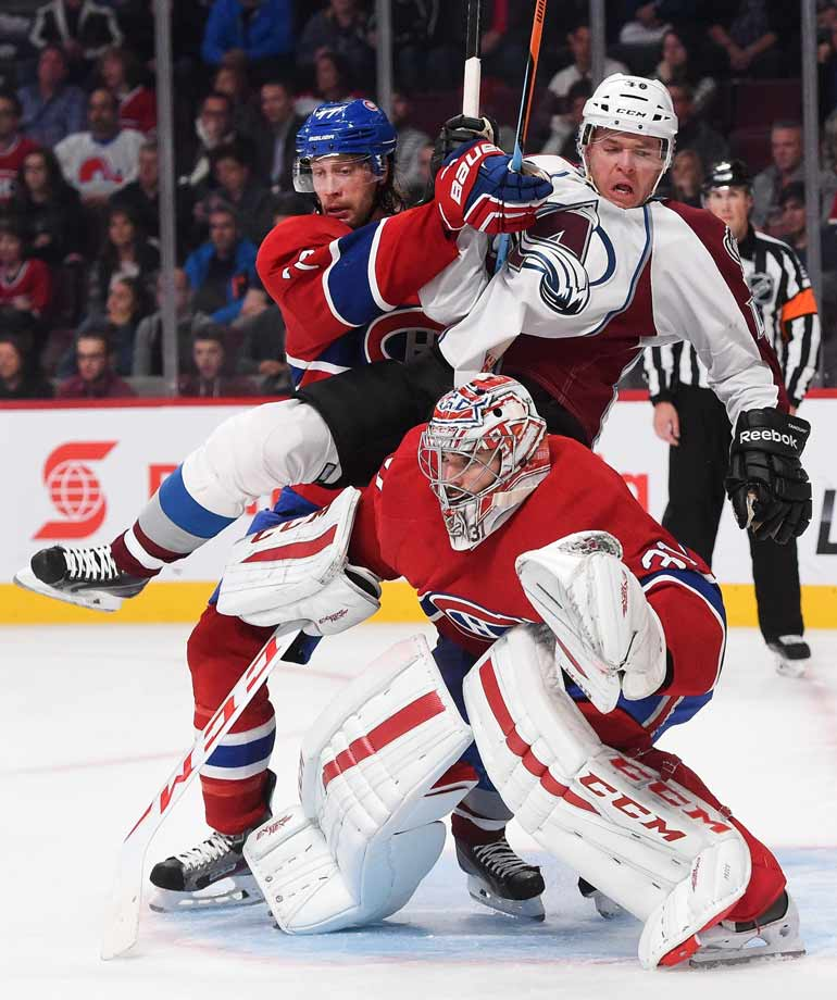 Alex Tanguay of the Avs was welcomed to Montreal by Canadiens defenseman Tom Gilbert on Oct. 18.
