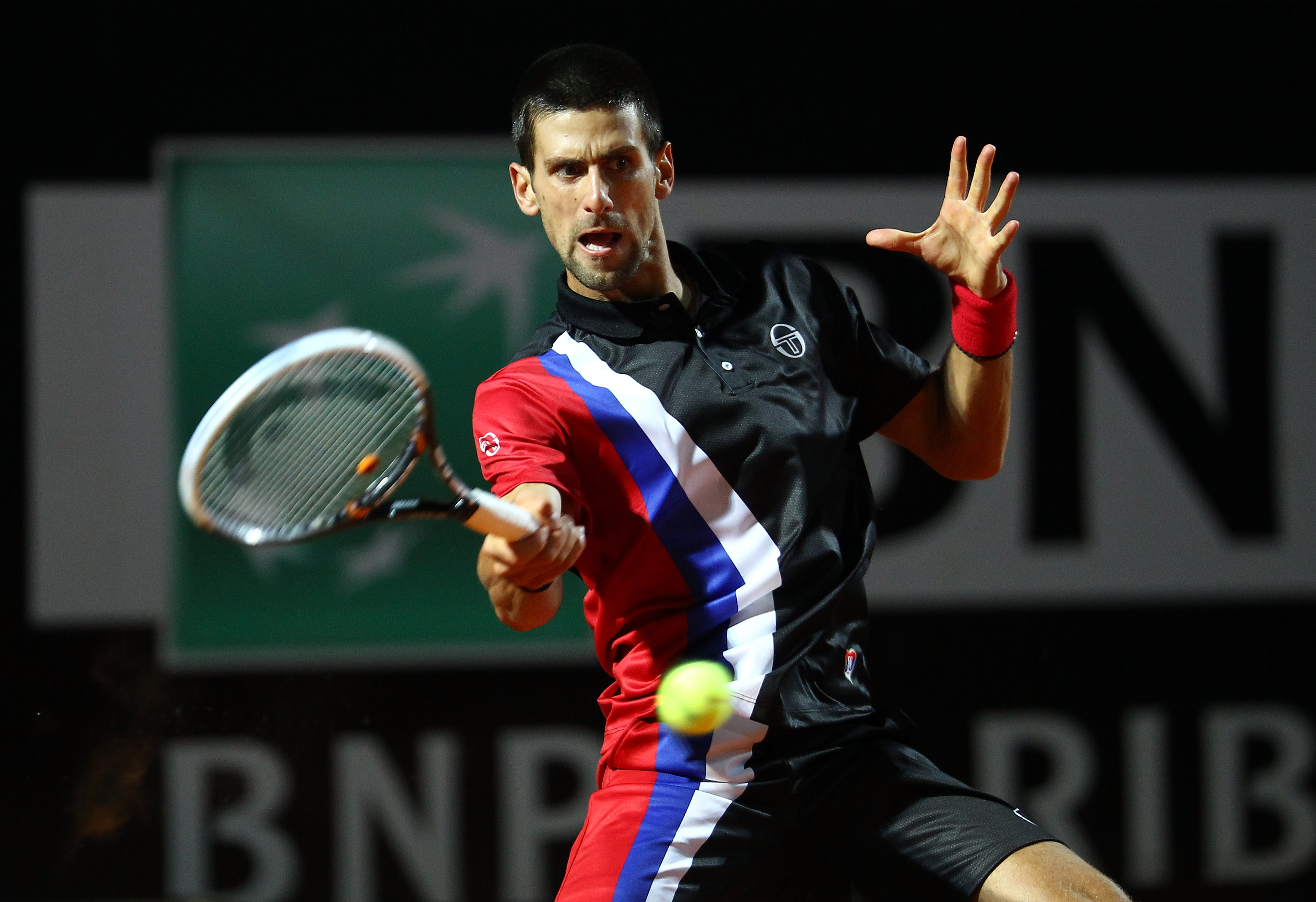 Djokovic went for a rare striped top and bottom in Rome.