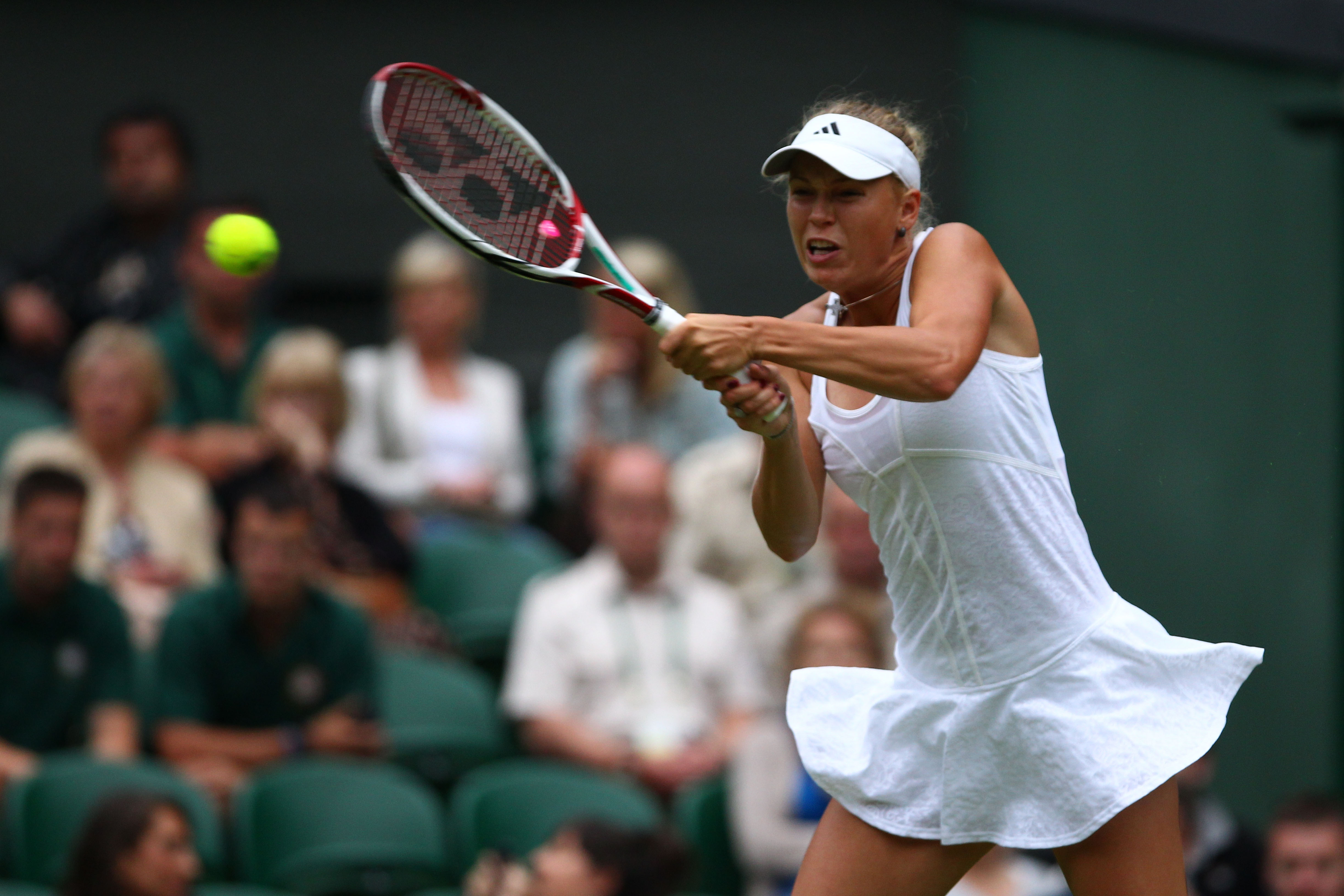 The perfect Wimbledon dress that lasted for just one match. Wozniacki lost to Tamira Pazcek in the first round.