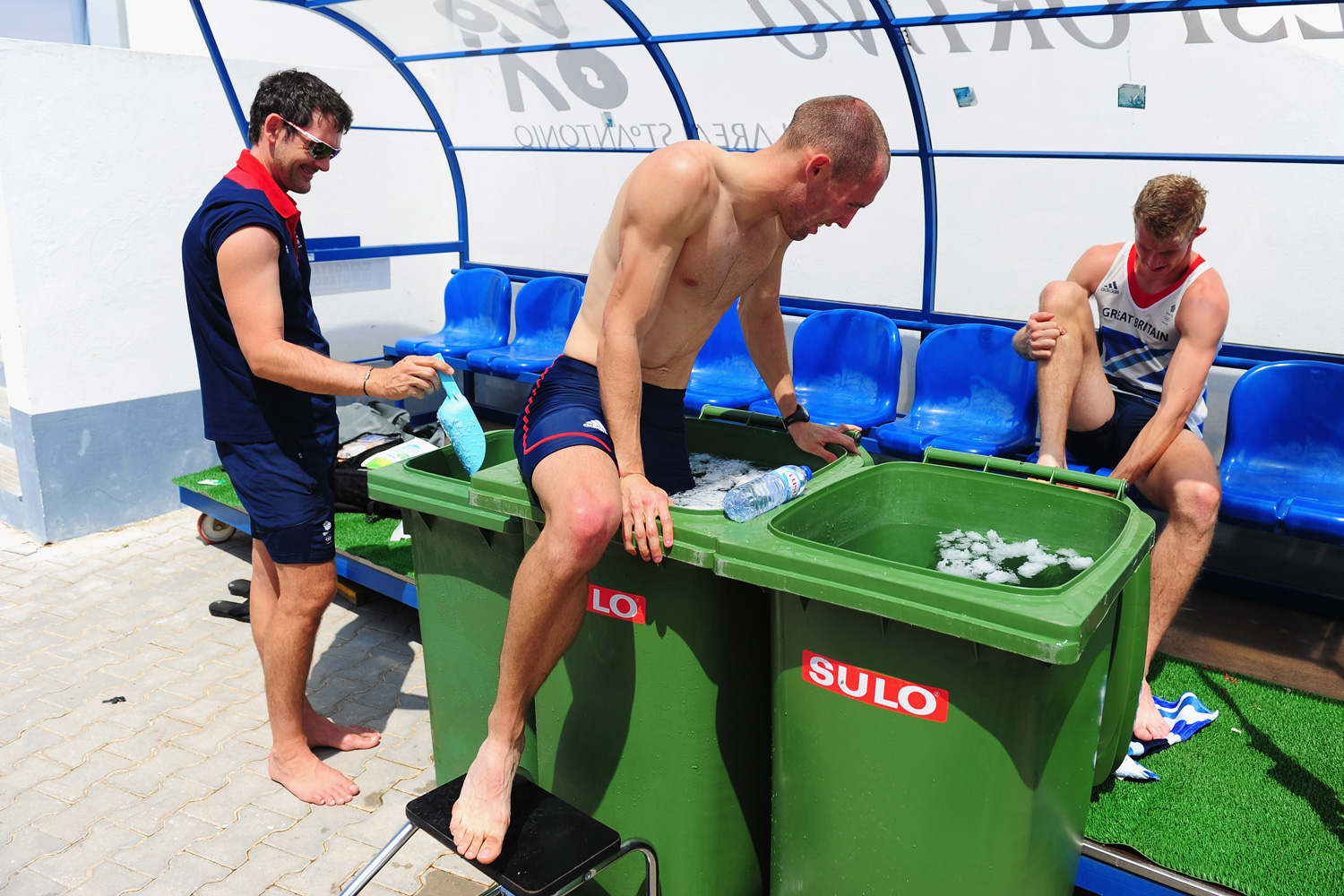 Champion hurdler Dai Greene (L) and Jack Green take an ice bath after their training session in Monte Gordo, Portugal.
