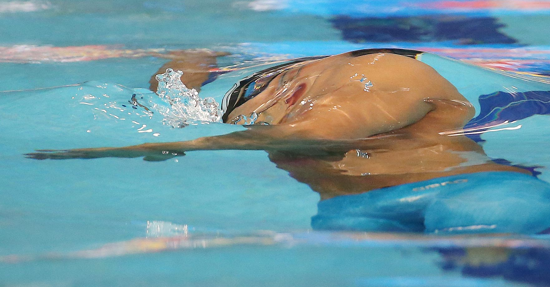 Japan's Junja Koga  swims 50-meter backstroke at the 17th Asian Games.