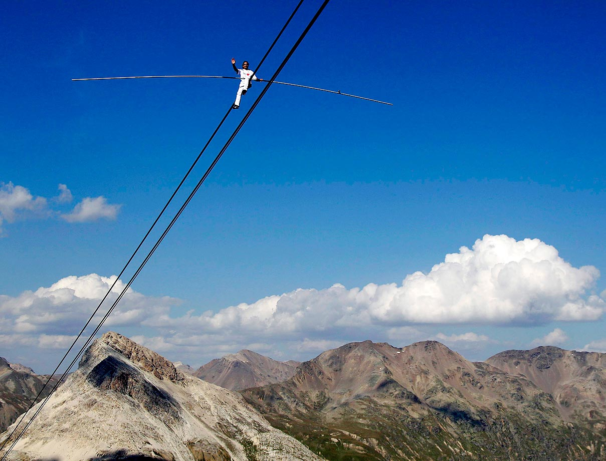 Swiss tightrope walker Freddy Nock walks on the carrying cable of the Diavolezza Cable Car towards the mountain station on 2,978 meters above sea level. Nock was attempting to set a new world record by doing seven summits in Germany, Austria and Switzerland in seven days.