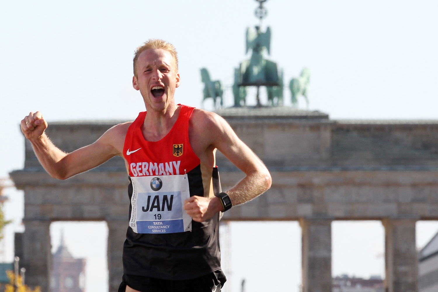 Jan Fitchen celebrates after crossing the finish line during the 39th Berlin Marathon in September 2012.