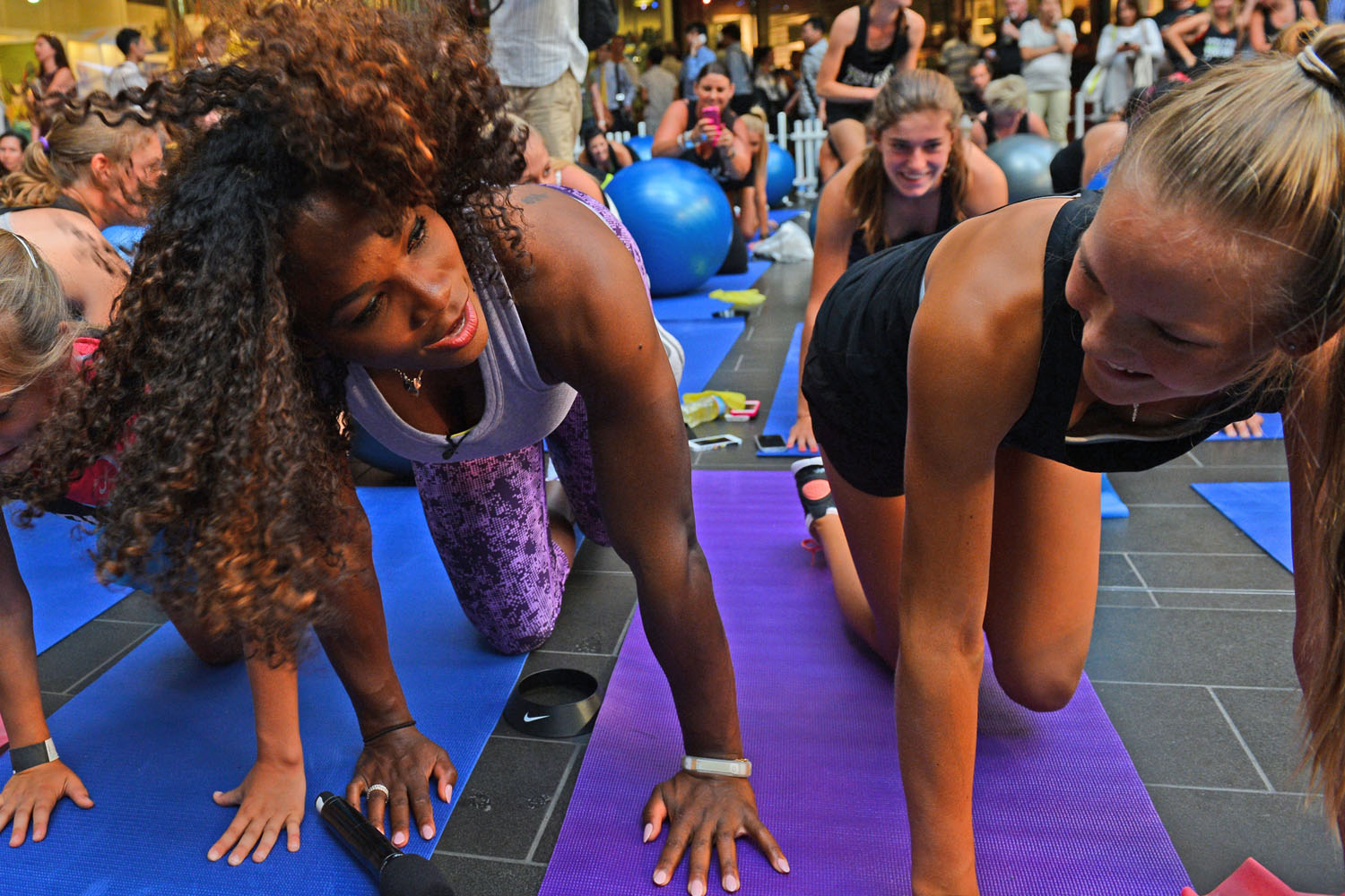 Serena Williams joins tennis fans at a sponsor's workout training club in Melbourne on January 8, 2013.