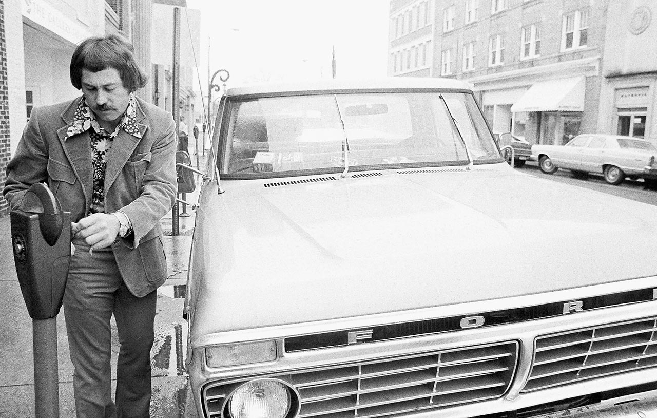 "Jim ""Catfish"" Hunter feeding the meter after parking his pickup truck in front of his lawyer's office in 1974.  Hunter was a free agent at the time, after he was under contract by the World Champion Oakland A's the year before."