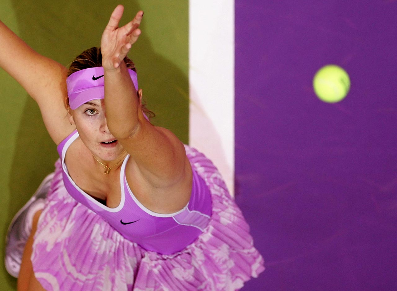 Sharapova serves against Kim Clijsters in Madrid at the WTA Championships in November 2006.