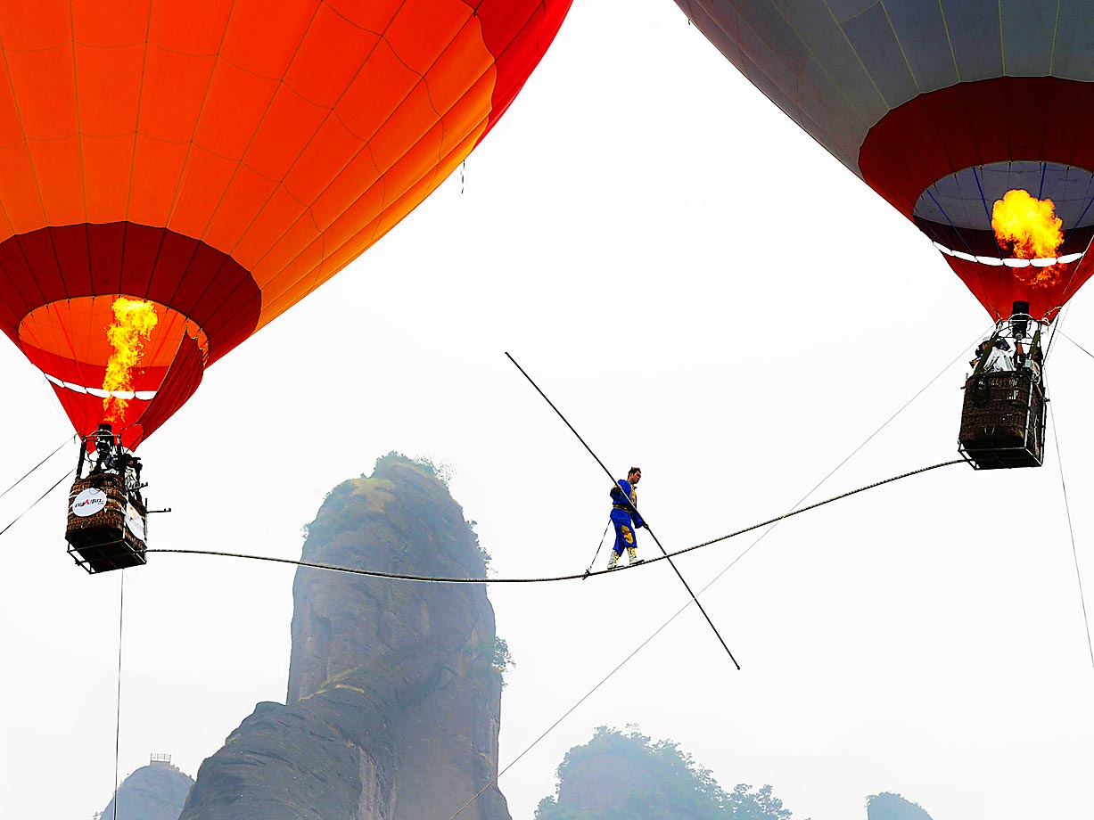 Saimaiti Aishan, a 27-year-old Uighur acrobat of tightrope walking, made history in August 2011 when he became the first person to walk on a 15-meter-long tightrope connected between two hot air balloons. He set a record for tightrope walking at 30 meters.