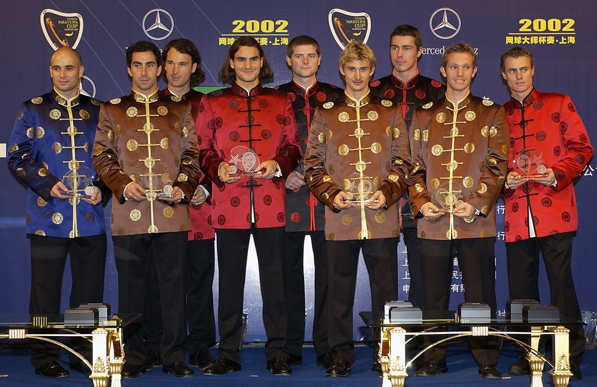 The top nine players of the 2002 ATP Champions Race line up for a team photograph during the Introduction Ceremony for the Tennis Masters Cup.