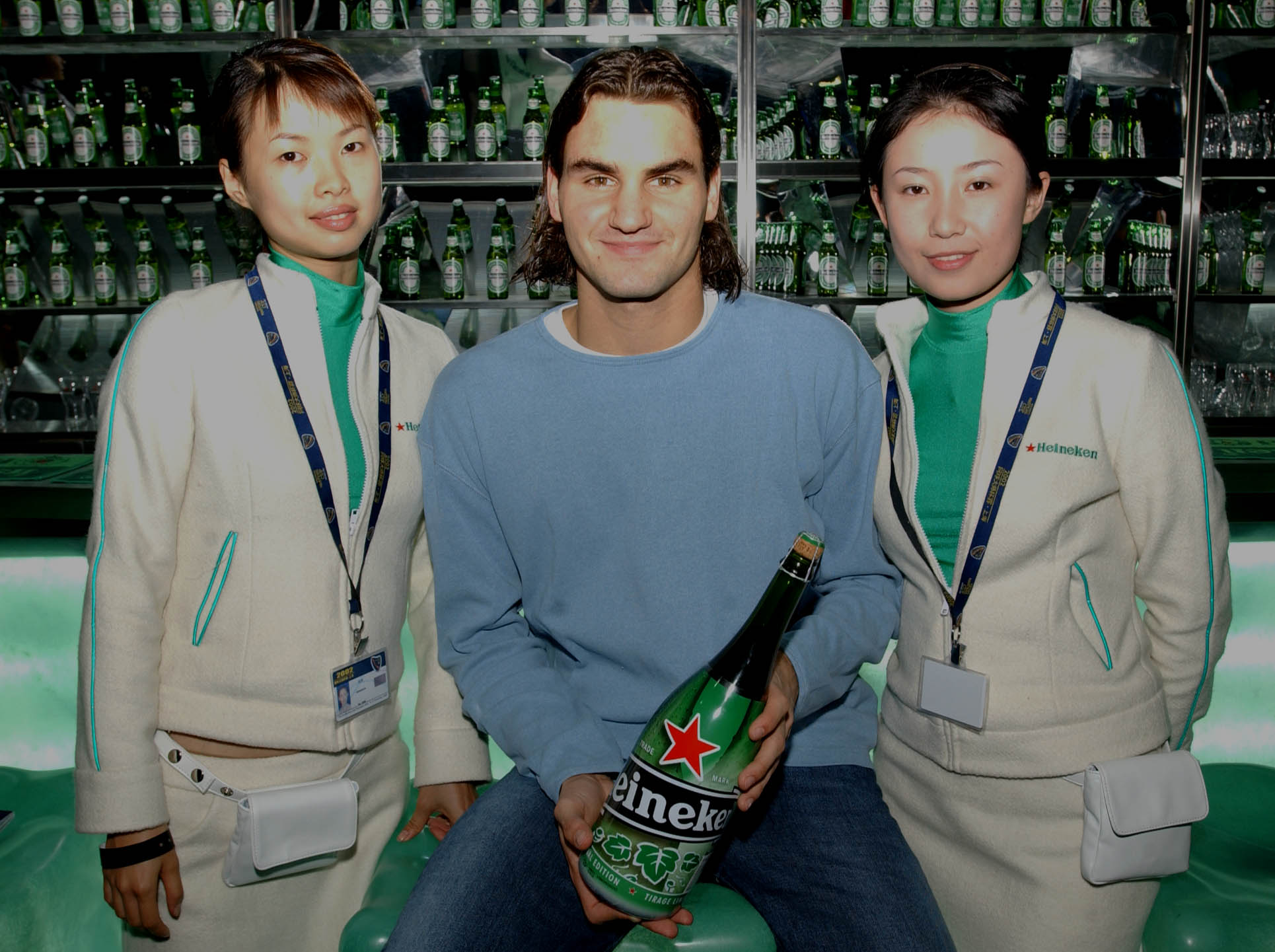 Roger Federer poses for pictures and signs autographs in the Heineken VIP hospitality area/