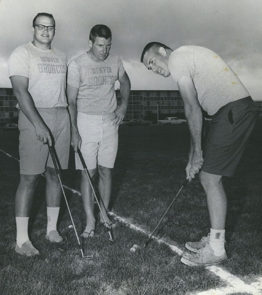 Jerry Hopkins, John McCormick and Don Breaux take a break from the grind of pre-season training for a little golf practice at Denver Broncos training camp in July 1964.