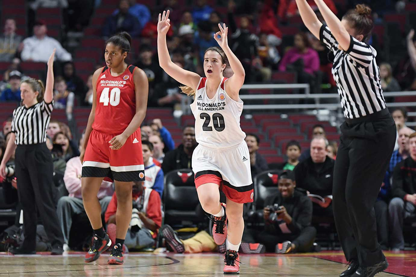 McDonald's All America MVP Sabrina Ionescu celebrates after scoring a three-point basket in overtime.