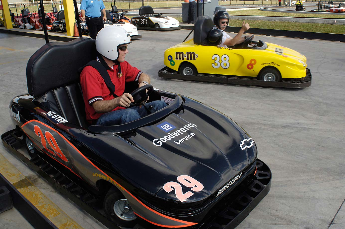 During his 2001 NASCAR rookie of the year season, Kevin Harvick gets the thumbs up from a fellow racer as he pulls on to the track at the NASCAR store. Harvick was on hand to sign autographs, race go-carts and to meet a lucky girl from the Make a Wish Foundation.