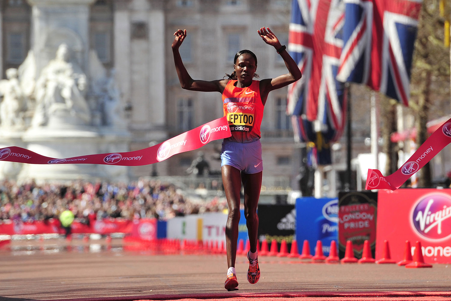 Priscah Jeptoo crosses the finish line to win the women's race in the 2013 London Marathon.