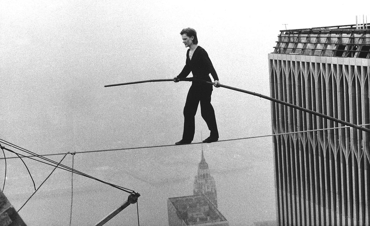 Philippe Petit, a French high wire artist, walks across a high wire suspended between the World Trade Center's Twin Towers in New York City.