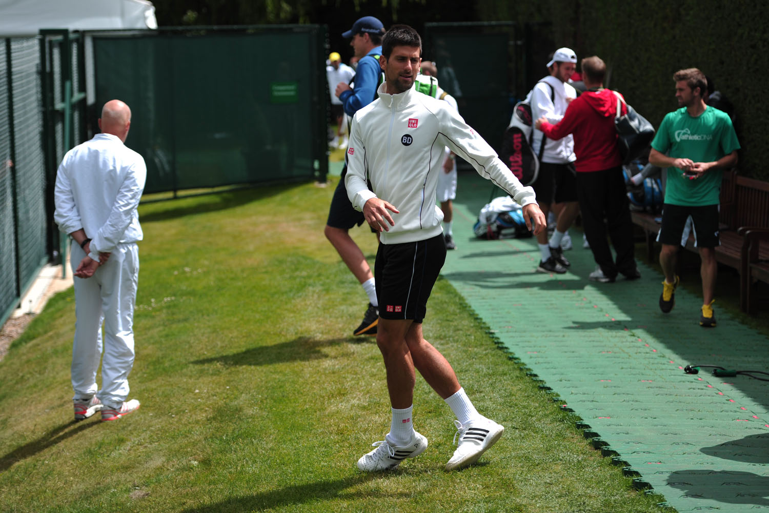 Novak Djokovic works out during a training session at the All England Tennis Club in Wimbledon, southwest London, on June 23, 2013, on the eve of the start of the 2013 Wimbledon Championships.